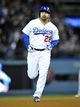 April 26, 2014; Los Angeles, CA, USA; Los Angeles Dodgers first baseman Adrian Gonzalez (23) rounds the bases after he hits a solo home run in the fifth inning against the Colorado Rockies at Dodger Stadium. Mandatory Credit: Gary Vasquez-USA TODAY Sports