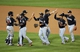 Apr 26, 2014; New York, NY, USA; New York Mets players celebrate the win against the New York Mets at Citi Field. Miami Marlins won 7-6 in ten innings. Mandatory Credit: Anthony Gruppuso-USA TODAY Sports
