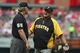 Apr 27, 2014; St. Louis, MO, USA; Pittsburgh Pirates manager Clint Hurdle (13) talks with umpire Ted Barrett (65) during the sixth inning against the St. Louis Cardinals at Busch Stadium. Mandatory Credit: Jeff Curry-USA TODAY Sports
