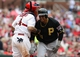 Apr 27, 2014; St. Louis, MO, USA; Pittsburgh Pirates right fielder Jose Tabata (31) is helped up by St. Louis Cardinals catcher Yadier Molina (4) after he was hit by a pitch during the sixth inning at Busch Stadium. St. Louis defeated Pittsburgh 7-0. Mandatory Credit: Jeff Curry-USA TODAY Sports
