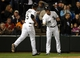 Apr 29, 2014; Chicago, IL, USA; Chicago White Sox third baseman Marcus Semien (5) celebrates with second baseman Gordon Beckham (15) after scoring a run against the Detroit Tigers in the third inning at U.S Cellular Field. Mandatory Credit: Jerry Lai-USA TODAY Sports