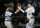 Apr 29, 2014; Chicago, IL, USA; Detroit Tigers relief pitcher Joe Nathan (36) shakes hands with catcher Bryan Holaday (50) after defeating the Chicago White Sox 4-3 at U.S Cellular Field. Mandatory Credit: Jerry Lai-USA TODAY Sports