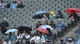 Apr 30, 2014; Chicago, IL, USA; People take cover from the rain during the sixth inning of a game between the Chicago White Sox and the Detroit Tigers at U.S Cellular Field. Mandatory Credit: David Banks-USA TODAY Sports