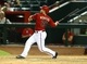 Apr 30, 2014; Phoenix, AZ, USA; Arizona Diamondbacks catcher Miguel Montero hits a walk off home run in the tenth inning against the Colorado Rockies at Chase Field. Mandatory Credit: Mark J. Rebilas-USA TODAY Sports