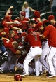 Apr 30, 2014; Phoenix, AZ, USA; Arizona Diamondbacks catcher Miguel Montero is congratulated by teammates after hitting a walk off home run in the tenth inning against the Colorado Rockies at Chase Field. Mandatory Credit: Mark J. Rebilas-USA TODAY Sports