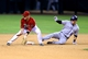 Apr 30, 2014; Phoenix, AZ, USA; Colorado Rockies base runner Corey Dickerson (right) slides into second base ahead of the tag by Arizona Diamondbacks infielder Chris Owings in the tenth inning at Chase Field. Mandatory Credit: Mark J. Rebilas-USA TODAY Sports