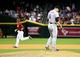 Apr 30, 2014; Phoenix, AZ, USA; Colorado Rockies pitcher Adam Ottavino (right) reacts after giving up a home run to Arizona Diamondbacks first baseman Paul Goldschmidt at Chase Field. Mandatory Credit: Mark J. Rebilas-USA TODAY Sports