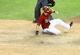 Apr 30, 2014; Phoenix, AZ, USA; Arizona Diamondbacks infielder Chris Owings slides into home to score in the ninth inning against the Colorado Rockies at Chase Field. Mandatory Credit: Mark J. Rebilas-USA TODAY Sports