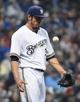 May 5, 2014; Milwaukee, WI, USA;  Milwaukee Brewers pitcher Matt Garza (22) reacts after giving up a run in the third inning during the game against the Arizona Diamondbacks at Miller Park. Mandatory Credit: Benny Sieu-USA TODAY Sports