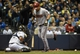 May 5, 2014; Milwaukee, WI, USA;  Arizona Diamondbacks right fielder Gerardo Parra (8) reacts after getting hit by a pitch in the third inning during the game against the Milwaukee Brewers at Miller Park. Mandatory Credit: Benny Sieu-USA TODAY Sports