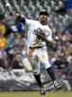 May 5, 2014; Milwaukee, WI, USA;   Milwaukee Brewers shortstop Jean Segura (9) throws out Arizona Diamondbacks first baseman Paul Goldschmidt (44) in the fourth inning at Miller Park. Mandatory Credit: Benny Sieu-USA TODAY Sports