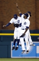 May 5, 2014; Detroit, MI, USA; Detroit Tigers left fielder Rajai Davis (left) center fielder Austin Jackson (center) and right fielder Torii Hunter (right) celebrate after the game against the Houston Astros at Comerica Park. Detroit won 2-0. Mandatory Credit: Rick Osentoski-USA TODAY Sports