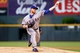 May 6, 2014; Denver, CO, USA; Texas Rangers starting pitcher Robbie Ross (46) pitches in the first inning against the Colorado Rockies at Coors Field. Mandatory Credit: Isaiah J. Downing-USA TODAY Sports