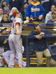 May 6, 2014; Milwaukee, WI, USA; Arizona Diamondbacks first baseman Paul Goldschmidt (44) reaches over the Milwaukee Brewers dugout to catch a foul ball during the second inning at Miller Park. Mandatory Credit: Jeff Hanisch-USA TODAY Sports