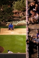 May 6, 2014; Denver, CO, USA; Fans watch as Texas Rangers relief pitcher Shawn Tolleson (37) warms up in the bullpen in the sixth inning against the Colorado Rockies at Coors Field. Mandatory Credit: Isaiah J. Downing-USA TODAY Sports