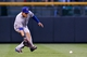 May 6, 2014; Denver, CO, USA; Texas Rangers left fielder Shin-Soo Choo (17) fields the ball in the third inning against the Colorado Rockies at Coors Field. Mandatory Credit: Isaiah J. Downing-USA TODAY Sports