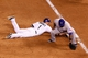 May 6, 2014; Denver, CO, USA; Texas Rangers first baseman Prince Fielder (84) makes an error allowing Colorado Rockies center fielder Brandon Barnes (1) to safely get to second base in the sixth inning at Coors Field. Mandatory Credit: Isaiah J. Downing-USA TODAY Sports