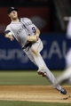 May 7, 2014; Arlington, TX, USA; Colorado Rockies special assistant Vinny Castilla (9) throws to first for the ground-out hit by Texas Rangers second baseman Josh Wilson (not pictured) during the ninth inning of a baseball game at Globe Life Park in Arlington. The Rockies won 9-2. Mandatory Credit: Jim Cowsert-USA TODAY Sports