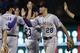 May 7, 2014; Arlington, TX, USA; Colorado Rockies third baseman Nolan Arenado (28) congratulates teammates following their 9-2 win over the Texas Rangers at Globe Life Park in Arlington. The Rockies won 9-2. Mandatory Credit: Jim Cowsert-USA TODAY Sports