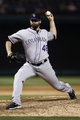 May 7, 2014; Arlington, TX, USA; Colorado Rockies relief pitcher Boone Logan (48) delivers a pitch to the Texas Rangers during the ninth inning of a baseball game at Globe Life Park in Arlington. The Rockies won 9-2. Mandatory Credit: Jim Cowsert-USA TODAY Sports