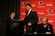 May 9, 2014; Atlanta, GA, USA; Atlanta Falcons general manager Thomas Dimitroff introduces first round draft pick tackle Jake Matthews (center) next to team owner Arthur Blank during a press conference at Falcons Training Facility. Mandatory Credit: Dale Zanine-USA TODAY Sports