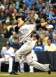 May 9, 2014; Milwaukee, WI, USA;  New York Yankees pitcher Masahiro Tanaka (19) strikes out in his first major league at bat in the third inning during the game against the Milwaukee Brewers at Miller Park. Mandatory Credit: Benny Sieu-USA TODAY Sports