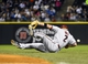 May 9, 2014; Chicago, IL, USA; Arizona Diamondbacks second baseman Aaron Hill (2) attempts to make a diving catch against the Chicago White Sox during the sixth inning at U.S Cellular Field. Mandatory Credit: Mike DiNovo-USA TODAY Sports