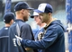 May 10, 2014; Milwaukee, WI, USA;  New York Yankees shortstop Derek Jeter (left) greets Milwaukee Brewers right fielder Ryan Braun (right), who is on the disable list, during batting practice at Miller Park. Mandatory Credit: Benny Sieu-USA TODAY Sports
