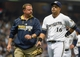 May 10, 2014; Milwaukee, WI, USA; Milwaukee Brewers third baseman Aramis Ramirez (16) walks off the field with trainer Dan Wright after injuring his hamstring in the fourth inning during the game against the New York Yankees at Miller Park. Mandatory Credit: Benny Sieu-USA TODAY Sports
