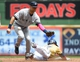 May 11, 2014; Milwaukee, WI, USA; Milwaukee Brewers center fielder Carlos Gomez (27) steals second base ahead of New York Yankees shortstop Derek Jeter (2) in the first inning at Miller Park. Mandatory Credit: Benny Sieu-USA TODAY Sports