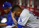 Sept. 17, 2013; Phoenix, AZ, USA: Los Angeles Dodgers pitcher Ronald Belisario reacts in the dugout against the Arizona Diamondbacks at Chase Field. Mandatory Credit: Mark J. Rebilas-USA TODAY Sports