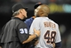 May 12, 2014; Baltimore, MD, USA; Detroit Tigers right fielder Torii Hunter (48) is restrained by umpire Paul Nauert (39) after being hit by a pitch in the eighth inning against the Baltimore Orioles at Oriole Park at Camden Yards. The Tigers defeated the Orioles 4-1. Mandatory Credit: Joy R. Absalon-USA TODAY Sports