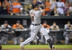 May 13, 2014; Baltimore, MD, USA; Detroit Tigers first baseman Miguel Cabrera (24) hits the game-winning three-run home run in the ninth inning against the Baltimore Orioles at Oriole Park at Camden Yards. The Tigers defeated the Orioles 4-1. Mandatory Credit: Joy R. Absalon-USA TODAY Sports