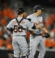 May 13, 2014; Baltimore, MD, USA; Detroit Tigers pitcher Joe Nathan (36) and catcher Bryan Holaday (50) celebrate after a game against the Baltimore Orioles at Oriole Park at Camden Yards. The Tigers defeated the Orioles 4-1. Mandatory Credit: Joy R. Absalon-USA TODAY Sports