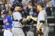 May 14, 2014; New York, NY, USA; New York Yankees starting pitcher Masahiro Tanaka (19) and catcher Brian McCann (34) celebrate the win against the New York Mets at Citi Field. New York Yankees won 4-0.  Mandatory Credit: Anthony Gruppuso-USA TODAY Sports