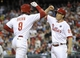 May 17, 2014; Philadelphia, PA, USA; Philadelphia Phillies left fielder Domonic Brown (9) celebrates with third baseman Cody Asche (25) after hitting a 2-run home run in the fourth inning against the Cincinnati Reds at Citizens Bank Park. Mandatory Credit: Eric Hartline-USA TODAY Sports
