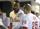 May 17, 2014; Philadelphia, PA, USA; Philadelphia Phillies left fielder Domonic Brown (9) and third baseman Cody Asche (25) celebrate after scoring in the seventh inning against the Cincinnati Reds at Citizens Bank Park. The Phillies defeated the Reds, 12-1. Mandatory Credit: Eric Hartline-USA TODAY Sports