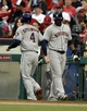 May 19, 2014; Anaheim, CA, USA; Houston Astros right fielder George Springer (4) celebrates with designated hitter Chris Carter (23) after scoring during the first inning against the Los Angeles Angels at Angel Stadium of Anaheim. Mandatory Credit: Kelvin Kuo-USA TODAY Sports