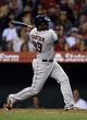 May 19, 2014; Anaheim, CA, USA; Houston Astros designated hitter Chris Carter (23) follows through on a swing for a RBI single during the third inning against the Los Angeles Angels at Angel Stadium of Anaheim. Mandatory Credit: Kelvin Kuo-USA TODAY Sports