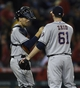 May 19, 2014; Anaheim, CA, USA; Houston Astros catcher Jason Castro (left) celebrates with relief pitcher Josh Zeid (right) after the game against the Los Angeles Angels at Angel Stadium of Anaheim. The Houston Astros won 6-2. Mandatory Credit: Kelvin Kuo-USA TODAY Sports