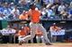 May 28, 2014; Kansas City, MO, USA; Houston Astros batter Chris Carter (23) hits a solo home run against the Kansas City Royals  during the fifth inning at Kauffman Stadium. Mandatory Credit: Peter G. Aiken-USA TODAY Sports