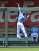 May 28, 2014; Kansas City, MO, USA; Kansas City Royals left fielder Alex Gordon (4) makes a leaping attempt on a home run from Houston Astros Chris Carter (not pictured) during the fourth inning at Kauffman Stadium. Mandatory Credit: Peter G. Aiken-USA TODAY Sports