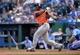 May 28, 2014; Kansas City, MO, USA; Houston Astros batter Chris Carter (23) hits a three run home run against the Kansas City Royals during the sixth inning at Kauffman Stadium. Mandatory Credit: Peter G. Aiken-USA TODAY Sports