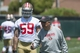 May 28, 2014; Santa Clara, CA, USA; San Francisco 49ers defensive coordinator Vic Fangio (right) instructs linebacker Aaron Lynch (59) during organized team activities at the SAP Performance Facility. Mandatory Credit: Kyle Terada-USA TODAY Sports