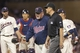 May 28, 2014; Minneapolis, MN, USA; Minnesota Twins manager Ron Gardenhire (35) talks to second base umpire Mike DiMuro about reviewing a play in the seventh inning against the Texas Rangers at Target Field. Mandatory Credit: Jesse Johnson-USA TODAY Sports