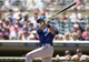 May 29, 2014; Minneapolis, MN, USA; Texas Rangers right fielder Alex Rios (51) hits a single in the second inning against the Minnesota Twins at Target Field. Mandatory Credit: Jesse Johnson-USA TODAY Sports