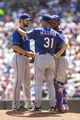 May 29, 2014; Minneapolis, MN, USA; Texas Rangers pitching coach Mike Maddux (31) talks to starting pitcher Nick Martinez (22) and catcher Robinson Chirinos (61) in the second inning at Target Field. Mandatory Credit: Jesse Johnson-USA TODAY Sports