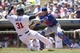 May 29, 2014; Minneapolis, MN, USA; Texas Rangers catcher Robinson Chirinos (61) forces out Minnesota Twins right fielder Oswaldo Arcia (31) at home plate in the second inning at Target Field. Mandatory Credit: Jesse Johnson-USA TODAY Sports