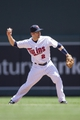 May 29, 2014; Minneapolis, MN, USA; Minnesota Twins second baseman Brian Dozier (2) throws the ball to first base for an out in the sixth inning against the Texas Rangers at Target Field. Mandatory Credit: Jesse Johnson-USA TODAY Sports