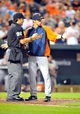 May 12, 2014; Baltimore, MD, USA; Detroit Tigers manager Brad Ausmus (7) argues a call with home plate umpire James Hoye (92) during a game against the Baltimore Orioles at Oriole Park at Camden Yards. The Tigers defeated the Orioles 4-1. Mandatory Credit: Joy R. Absalon-USA TODAY Sports